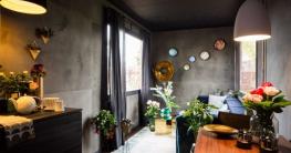So wird die Gartenlaube zu einer eleganten Unterkunft: Dunkles Grau an den Wänden und moderne Möbel